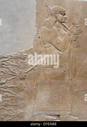 relief depicting a king and eunuch attendant, 883–859 b.c.; Neo–Assyrian period, reign of Ashurnasirpal II. Excavated - Stock Photo