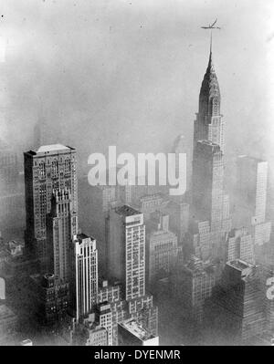Smog obscures view of Chrysler Building from Empire State Building, New York City - Stock Photo