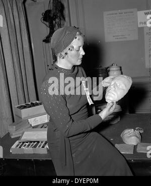 Death masks displayed at identification convention. Sept. 29. Mrs. Clark Schilder, wife of the Chief of the Division - Stock Photo