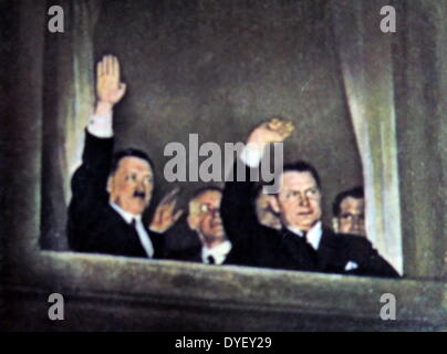 Herman Goring Right and Adolf Hitler left wave to supporters from a window at the Reichs Chancellor's office. - Stock Photo