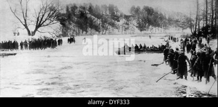 world war one German soldiers cross a river during the First Battle of the Masurian Lake. This was a German offensive - Stock Photo