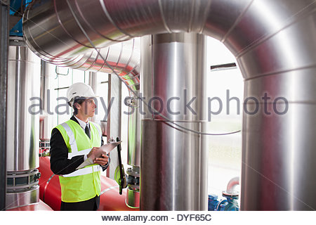 Scientist with clipboard in warehouse - Stock Photo