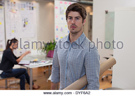 Portrait architect holding blueprint tubes in office stock photo portrait architect holding blueprint tubes in office stock photo malvernweather Image collections