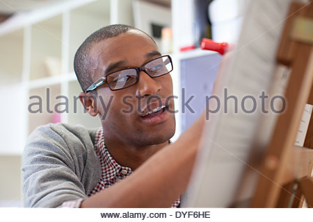 Close up of businessman writing on chart - Stock Photo