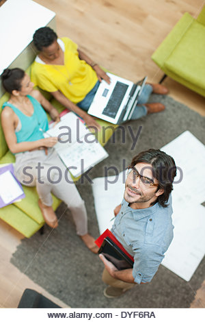 Portrait of smiling businessman in meeting - Stock Photo