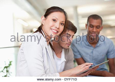 Business people using digital tablet in meeting - Stock Photo