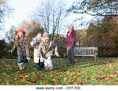 Grandmother playing with grandchildren outdoors - Stock Photo