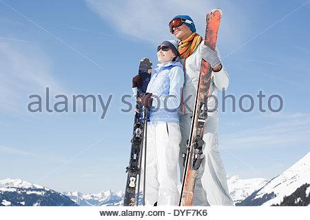 Couple holding skis - Stock Photo
