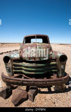 A rusty old pickup truck stands on the side of the road near Fish River Canyon in the south of Namibia, 08 January - Stock Photo
