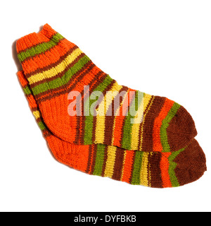 Hand knitted warm wool socks on a white background - Stock Photo