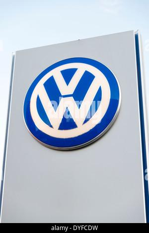 VW sign at a garage, UK. - Stock Photo