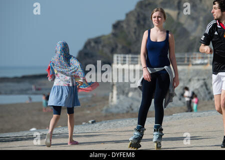 Aberystwyth, Wales, UK. 16th April 2014.   A young woman on rollerblades enjoying the sunshine on the promenade - Stock Photo