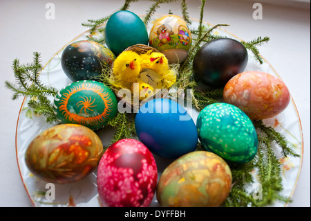 Traditional Easter eggs or Paschal eggs, decorated by boiling in dye, with onion skins and linseed. - Stock Photo