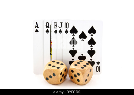 royal flush of cards in spades with two wooden dice - Stock Photo