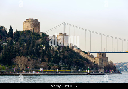 The Fortress of Rumeli Hisari and Fatih Sultan Mehmet bridge, taken from the deck of a Bosphorus cruise boat, Istanbul, - Stock Photo