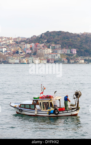 Small fishing boat on the Bosphorus, Istanbul, Turkey - Stock Photo