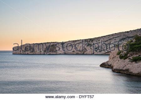 Calanque de Sugiton at sunset, Parc National des Calanques, Bouches-du-Rhône, Provence-Alpes-Côte d'Azur, France - Stock Photo