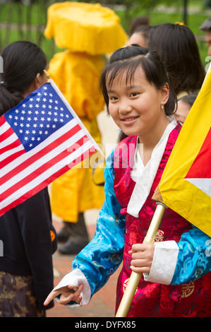Tibetan girl in traditional dress with Flags - Stock Photo
