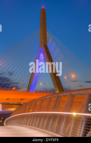 The sky begins to lighten during morning twilight behind one of the suspension towers of the Leonard P. Zakim Bunker - Stock Photo