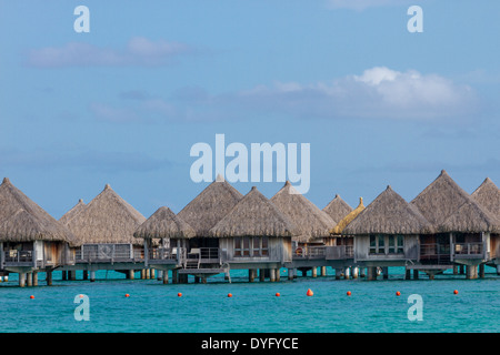 Overwater bungalows with turquoise water in Bora Bora, French Polynesia - Stock Photo