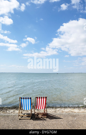 Two empty deck chairs on Southend seafront. - Stock Photo