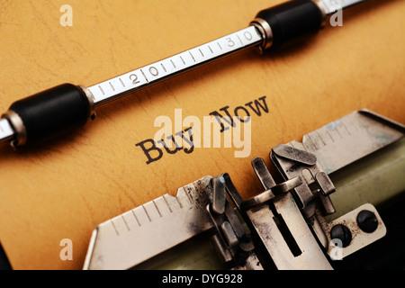 Buy now text on typewriter - Stock Photo
