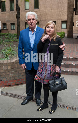 London, UK. 17th April 2014. Publicist Max Clifford (L) leaves Southwark Crown Court with daughter Louise (R) on - Stock Photo