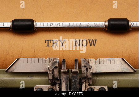 Try now text on typewriter - Stock Photo