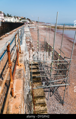 Looking down onto scaffolding surrounding a damaged set of steps that form part of Dawlish Sea Wall - Stock Photo
