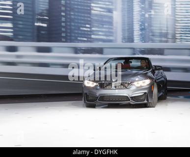President and CEO BMW North America Ludwig Willisch drives BMW convertible at unveiling edition 2015 cars at New - Stock Photo