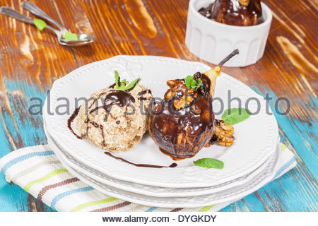 Spiced Poached Pear With Warm Chocolate Sauce and ice cream - Stock ...