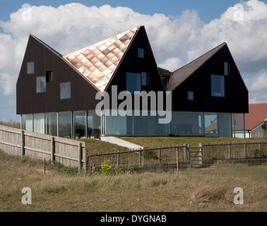 Sunshine shining on metal roof of modern house The Dune House on the seafront at Thorpeness, Suffolk, England - Stock Photo