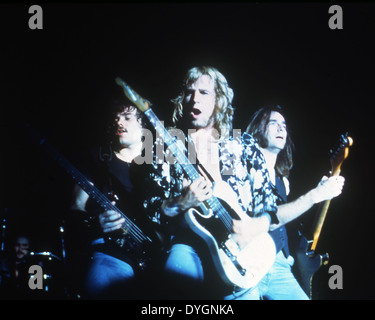 STATUS QUO UK rock group in 1976. from l: Alan Lancaster,Rick Parfitt, Francis Rossi - Stock Photo
