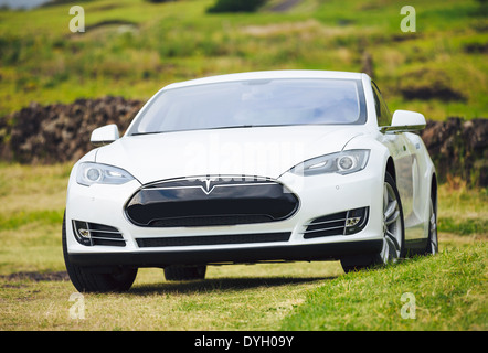 Tesla Motors model S sedan electric car on country road, - Stock Photo