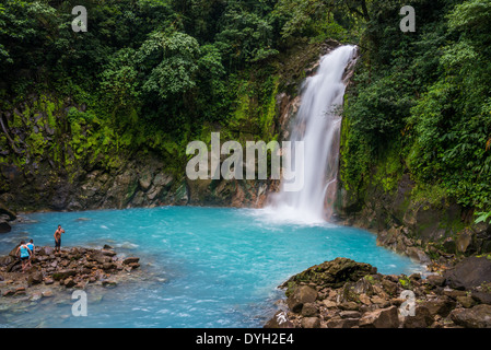 Signature turquoise blue water at the waterfall of the Rio Celeste, Tenorio Volcano National Park, Costa Rica. - Stock Photo