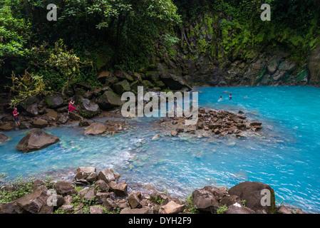 Signature turquoise blue water in the Rio Celeste, Tenorio Volcano National Park, Costa Rica. - Stock Photo