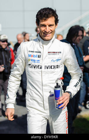Northampton, UK. 18th Apr, 2014. Ex-F1 driver Mark Webber (AUS) from the Porsche WEC Team looks on after a group - Stock Photo