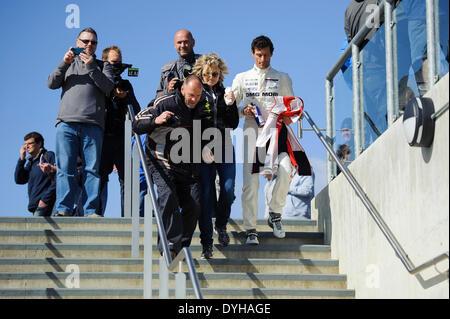 Northampton, UK. 18th Apr, 2014. Fans pursue ex-F1 driver Mark Webber (AUS) from the Porsche WEC Team for photos - Stock Photo