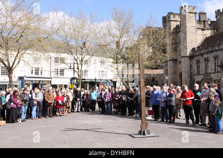 Wells, Somerset, UK. 18th April, 2014.  – Easter Good Friday Christians gather for an open air service in the Market - Stock Photo