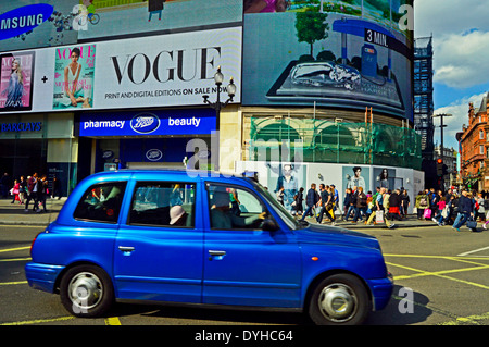 Taxi at Piccadilly Circus showing electric billboards, West End, London, England, United Kingdom - Stock Photo