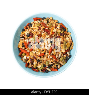 Bowl of homemade granola with various seeds and berries shot from above isolated on white background - Stock Photo