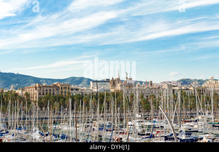 Barcelona, Spain - October 12: City of Barcelona landscape and sail boats in Port Vell. Port Vell is a waterfront - Stock Photo