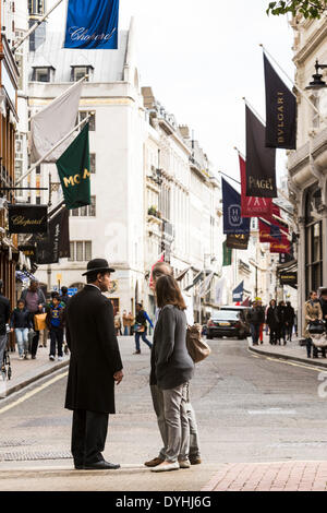 London, UK. 18th April 2014. Bond Street, the most expensive street in Europe on Friday, 18 April, 2014, London, - Stock Photo