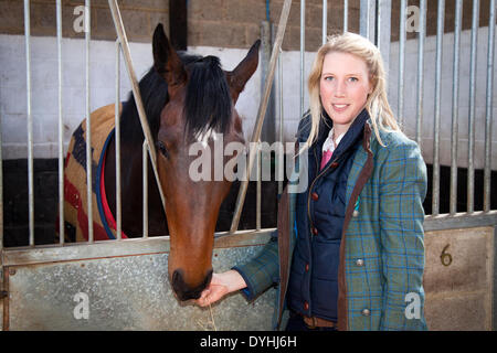 Middleham, Yorkshire, UK. 18th April 2014.  Lousie Black, with 'Unamed' , 2012 bay filly, by 'Holy Roman Emperorer' - Stock Photo