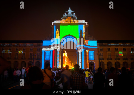 Triumphal Arch during a 3D outdoor light show - The Arch of Light - at Praca do Comercio, Lisbon, Portugal- - Stock Photo
