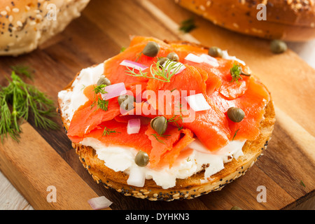 Homemade Bagel and Lox with Cream Cheese, Capes, and Dill - Stock Photo