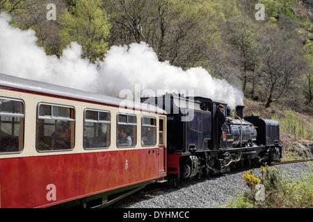 Welsh Highland Railway steam train engine 87 travelling along Aberglaslyn Pass in Snowdonia. Beddgelert Gwynedd North Wales UK