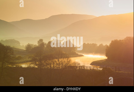 early morning mist on the Caledonian Canal - Stock Photo