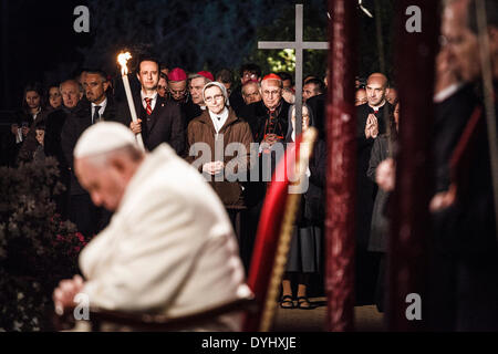Rome, Italy – April 18, 2014: Faithful hold the cross during a station during the Via Crucis (Way of the Cross) - Stock Photo