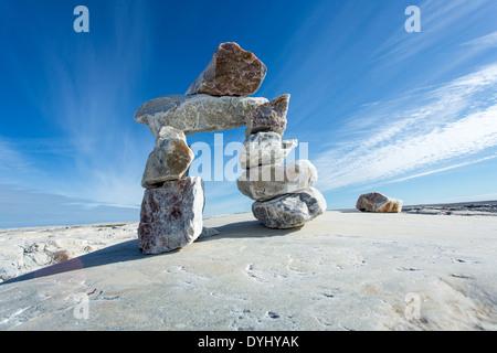 Canada, Nunavut Territory, Inukshuk rock sculpture on Marble Island along Hudson Bay - Stock Photo